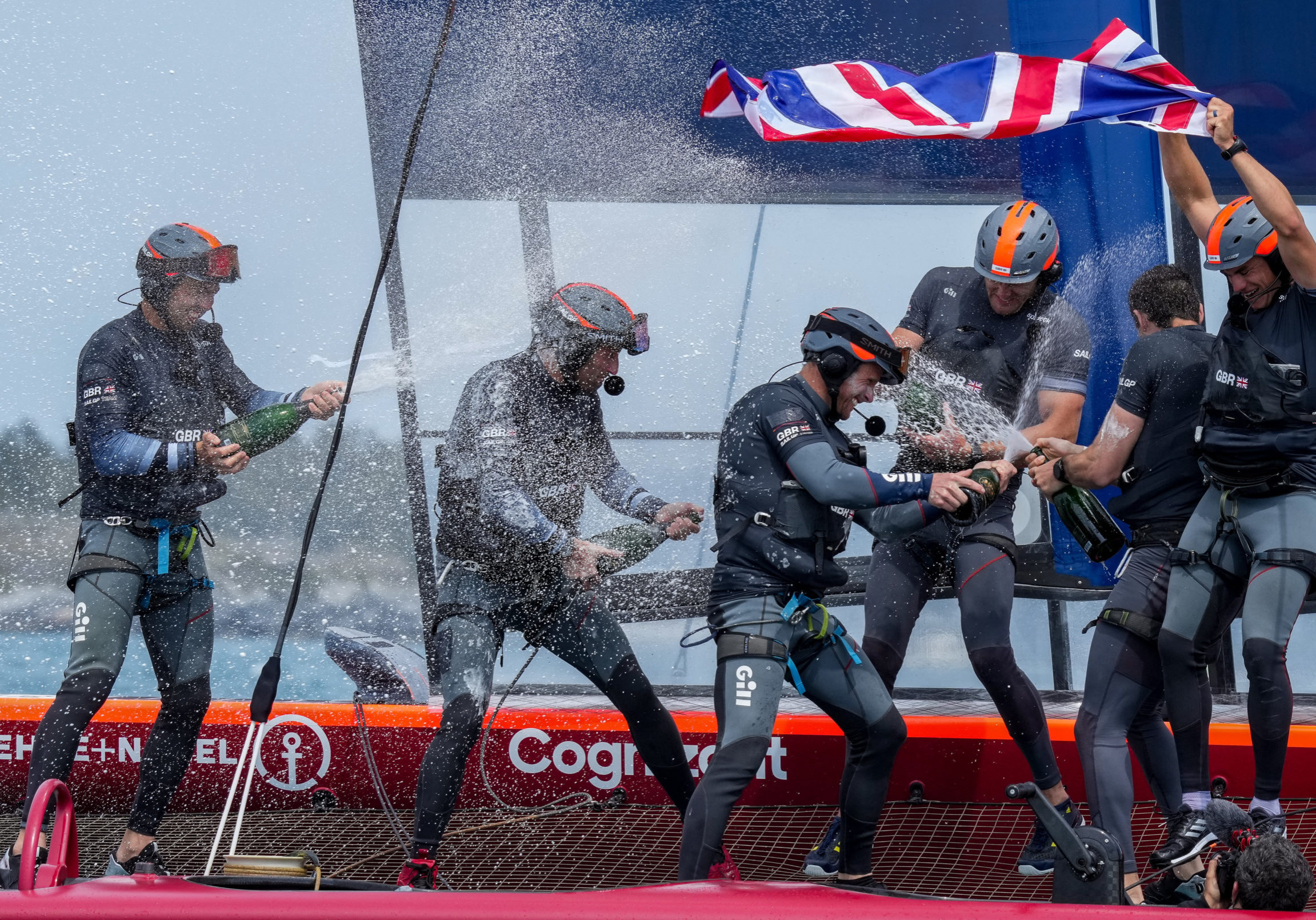 Sir Ben Ainslie and the Great Britain SailGP Team presented by INEOS remain on their F50 due to COVID-19 restrictions to celebrate their win with Champagne Barons de Rothschild in the final race on Race Day 2. Bermuda SailGP presented by Hamilton Princess, Event 1 Season 2 in Hamilton, Bermuda. 25 April 2021. Photo: Bob Martin for SailGP. Handout image supplied by SailGP